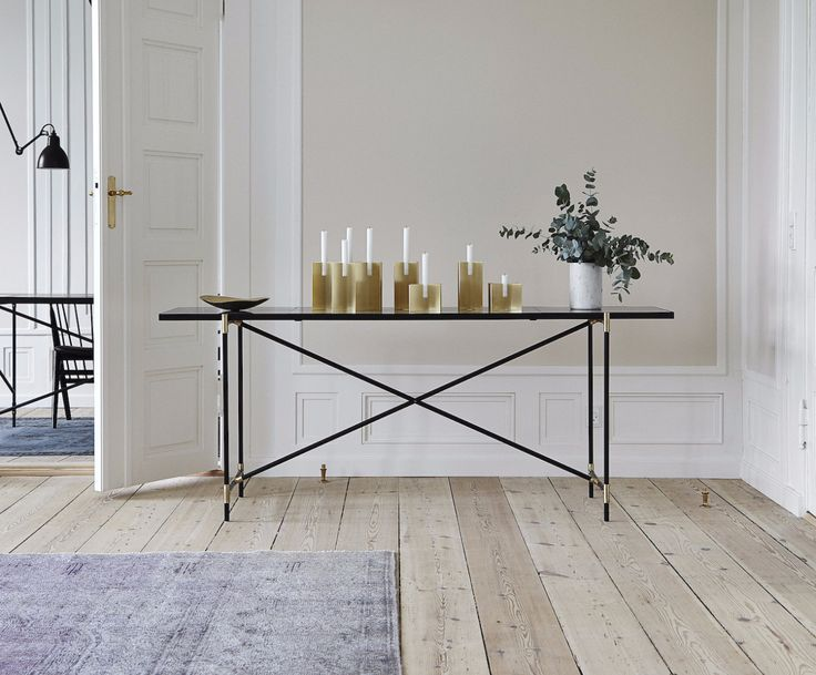 The HANDVÄRK Console // Brass on Black // White Marble at the HANDVÄRK Showroom in Copenhagen. Styled with Cross Candles designed by Laura Bilde and a small bowl made of brass from Louise Roe