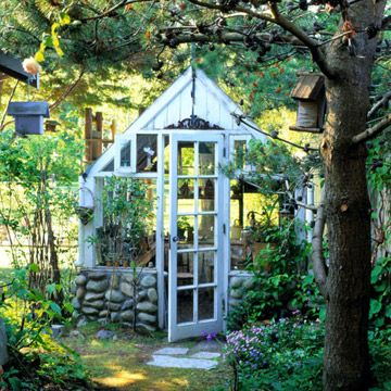 This greenhouse kit looks like it is part of a 19th-century estate garden.