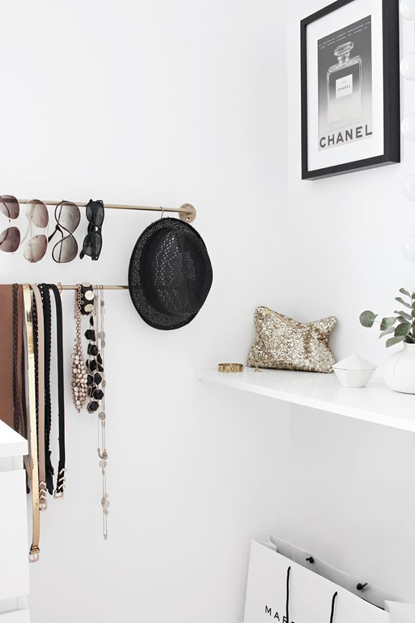 I love the idea of using a super chic brass towel rack to organize your belts, jewelry and sunnies! These are some of the most awkward accessories to keep tidy. Belts don't keep shape when you roll them, necklaces get tangled and sunnies just take up so much counter space. This simple fix would SO solve my problem of always hunting for my latest fave pair of sunglasses!: