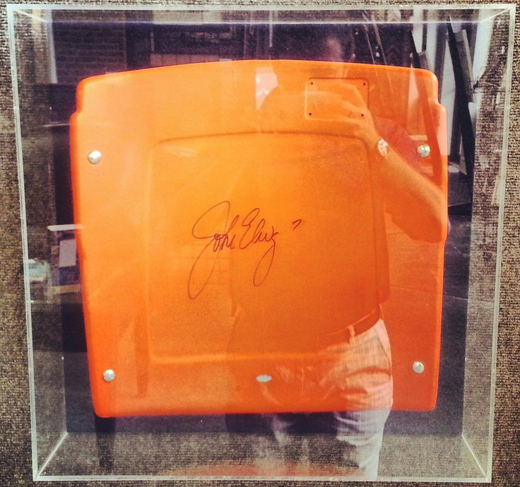 A seat from Mile High Stadium in a custom plexiglass box signed by ...