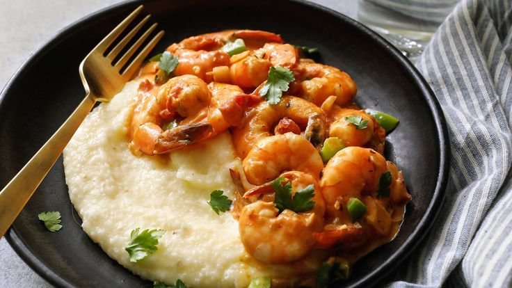 Once a popular morning meal throughout the South, shrimp and grits is no longer restricted to breakfast tables below the Mason-Dixon line Variations of the dish now appear on breakfast, lunch and dinner menus across the country from Maine to Oregon This recipe is an adaptation of one that Julia Reed discovered at Pearl's Café, a restaurant in landlocked Sewanee, Tenn., that evokes shrimp cardinale, a dish found in New Orleans