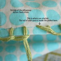 Blanket-stitching around a pillowcase in preparation for crocheted edge.