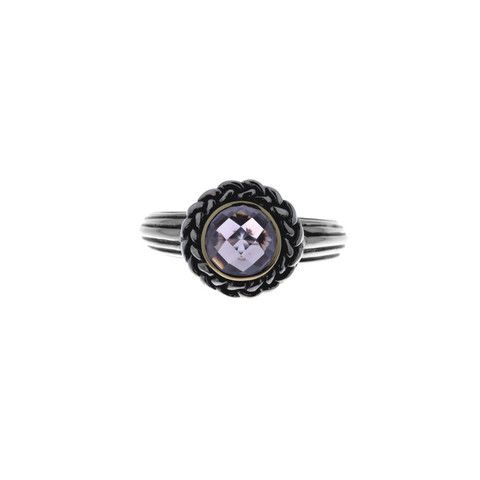 Ionian amethyst ring with 14k yellow gold surrounding an 8mm diameter amethyst and finished with a sterling silver plait. The silver is oxidised to enhance the pattern.