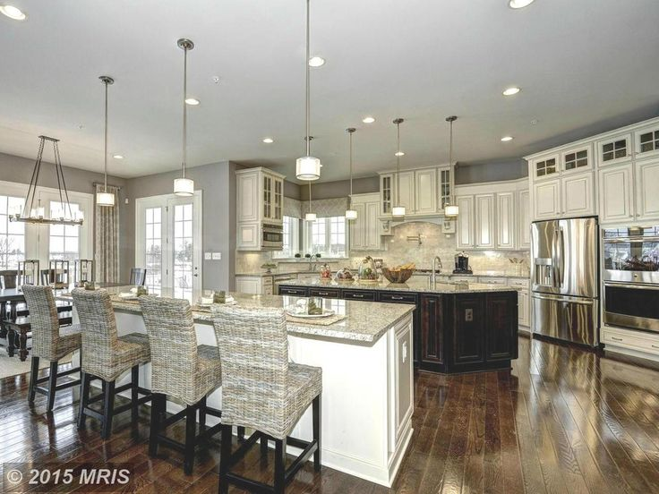 spacious kitchen with two islands kitchens