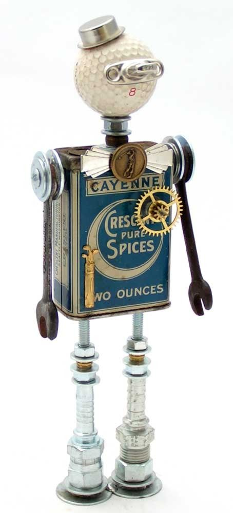 """Caddie"""" Height: 10.5"""" Principal Components: Spice tin, golf ball, tonneau cover latch, wrenches, hose fittings, clock gear, button"""