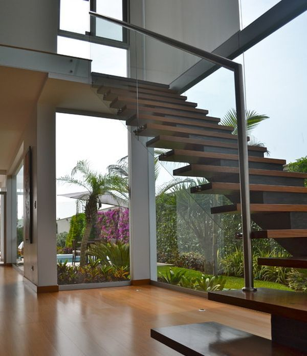 Extensive use of glass in the backdrop provides the ideal setting for this floating stairway