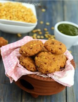 Rajasthani food is as colourful and diverse, as its glorious heritage. Rajasthanis are very fond of eating and this is reflected in the vast repetoire of recipes that they have devised out of fairly ordinary ingredients. Kalmi vadas are deep fried gram dal crispies that can be enjoyed with a fiery green chutney. You can prepare large vadas as in this recipe ahead of time and double fry (re-fry) them just before serving. These are perfect as a tea-time or pre-dinner snack.