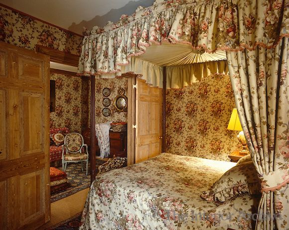 This Clically English Four Poster Bedroom And Adjacent Sitting Room Is Decorated In A Geoffrey Bennison Chintz