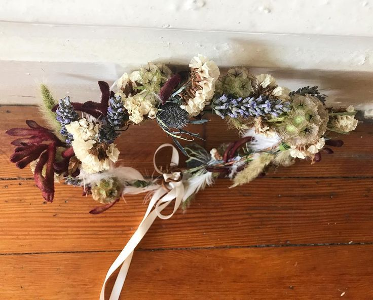 bridal flower crown with scabiosa pod, thistle, lavender, bunny tail grass, statice, kangaroo paw and feather for a wedding in Joshua Tree
