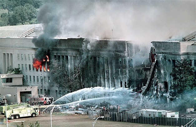Emergency crews spray water on the burning Pentagon approximately three hours after a hijacked jetliner crashed into the building's west side on Sept. 11, 2001. Part of the building collapsed 32 minutes after the crash.