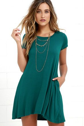 The question of the hour is: when will you NOT want to wear the Twenty-four Seven Teal Shift Dress?! Slinky jersey knit fabric shapes a classic tee dress with a rounded neckline and short sleeves. Swing silhouette travels down into a relaxed-fitting hem with hidden side seam pockets below the waist. Unlined. 95% Rayon, 5% Spandex. Hand Wash Cold.