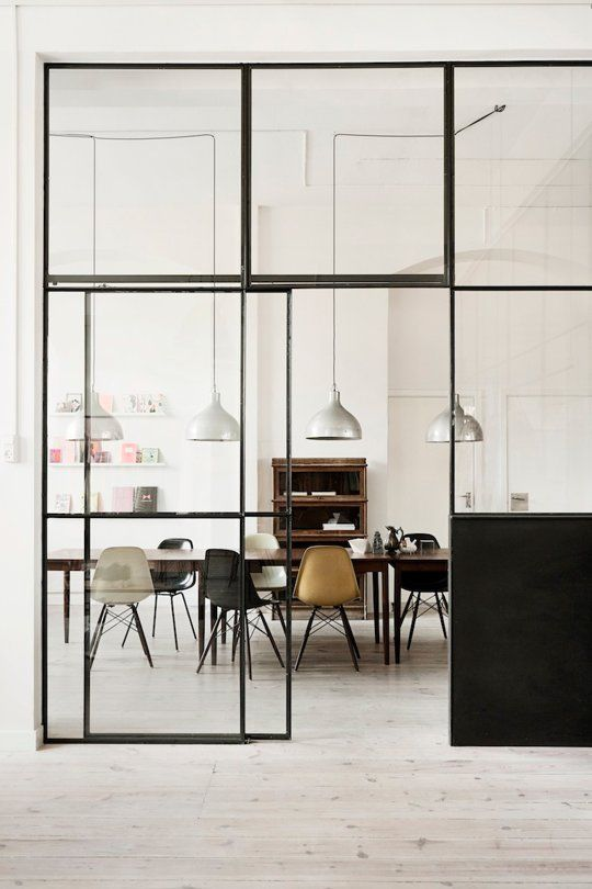 Love the look of these steel windows - this picture is a room separator within the space, but other pictures on this page have exterior steel windows and doors as well.