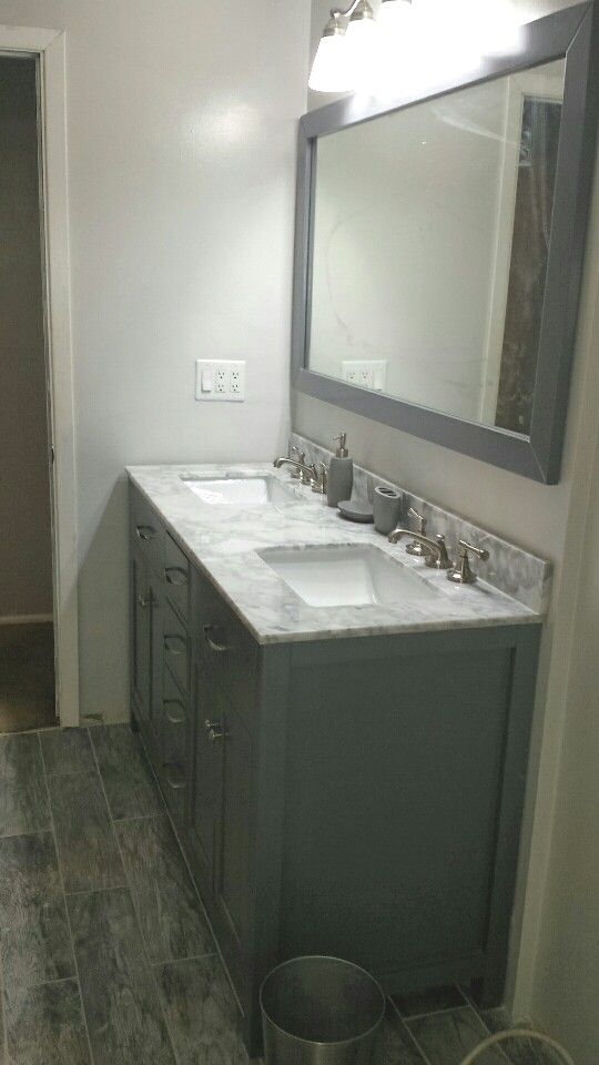 Tempered gray wall paint from valspar. Semi gloss. Our bath had no window so I got daylight bulbs to brighten it up.