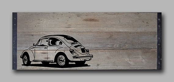 """Reclaimed Barn Wood Wall Art Barnwood painting with silhouette of vintage VW beetle. This piece measures 41"""" x 17"""" x 1"""". The top and bottom have 1"""" angle iron as borders.  150.00"""