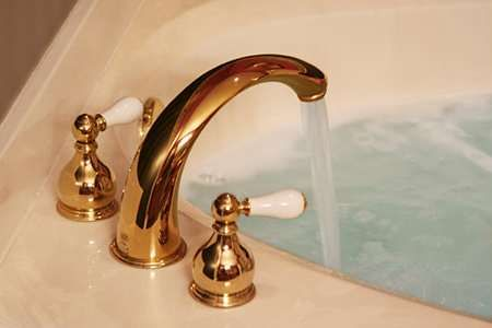 How to Replace a Bathtub Faucet | DoItYourself.com
