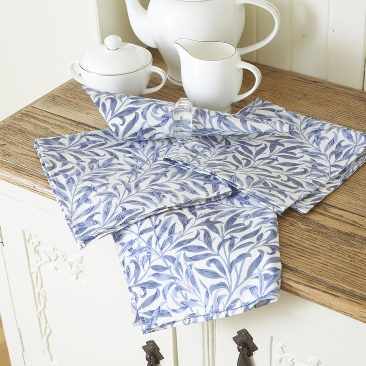 William Morris Willow Bough Blue Pack Of 4 Cotton Floral Napkins.   Napkins   Laura's Beau Ltd. This Licenced William Morris Willow Bough Blue Design was first designed in 1887. It was first produced as a wallpaper design which William's daughter, May Morris used to decorate her bedroom before being adapted for fabric in 1895 when it was block printed in Merton Abbey.