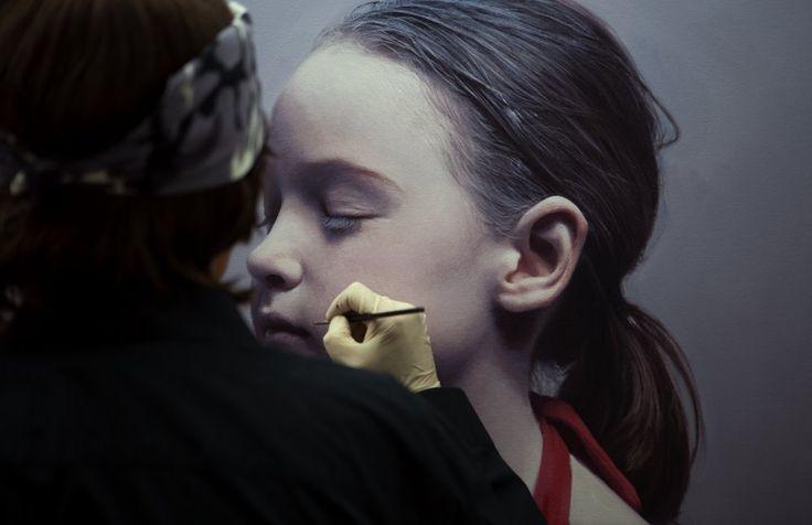 Gottfried Helnwein, It looks like he's painting ON a little girl. Description…