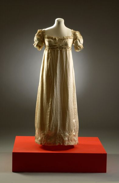 Fashion Museum (beneath the Assembly Rooms in Bath, England) -- This dress, typical of the neoclassical cut in women's fashion of the early 19th century, exemplifies the type of display (by decade, starting with a silver tissue court gown from the 17th century) utilized in the Fashion Museum