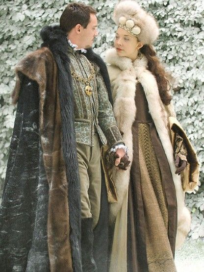 Anne in a brown gown with a fur cloak/jacket and matching fur hat.  She is on a walk with Henry right before he tells her he is taking her to Paris  so he can introduce her as the future Queen of England to King Francis-2.2