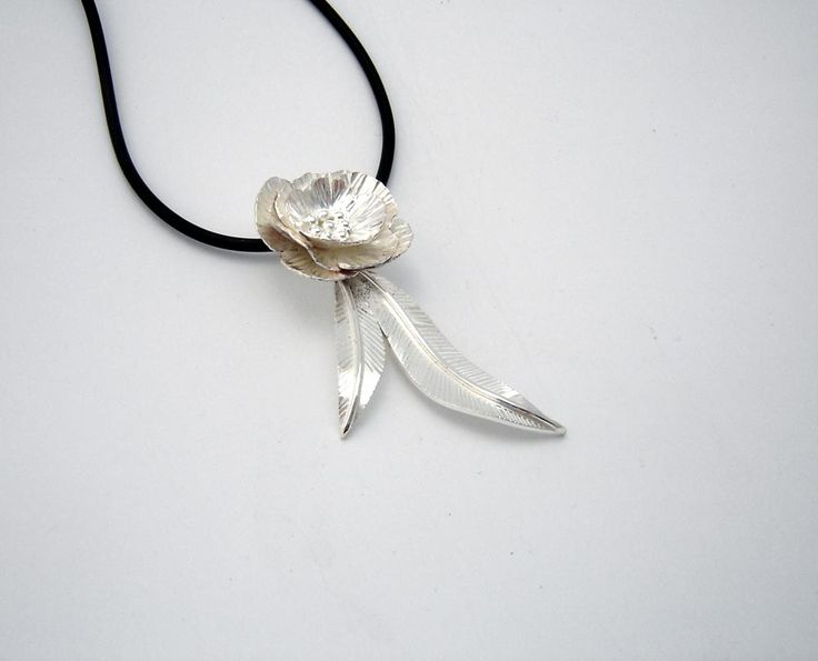 Adorned by Sally Sterling silver gum leaf and flower pendant