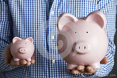 Man Holding Large And Small Piggy Bank - Download From Over 32 Million High Quality Stock Photos, Images, Vectors. Sign up for FREE today. Image: 49012858