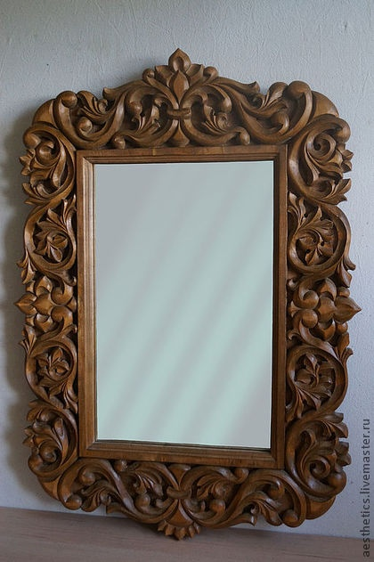 The frame for the #mirror is executed on #motives of #openwork #woodcarving.  Relief carving with the selected background. #Russian carver #Vladimir Kolesyankin