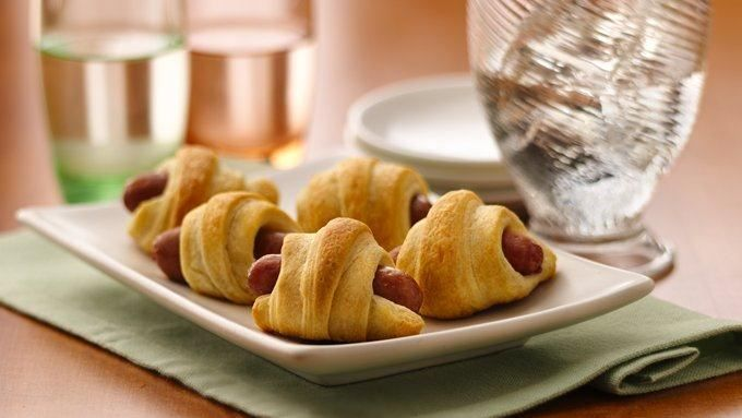 Mini sausages are all wrapped up in flaky crescents in an all-time favorite appetizer.