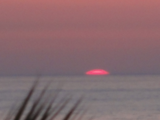 SUN DISAPPEARING INTO THE CRETAN SEA