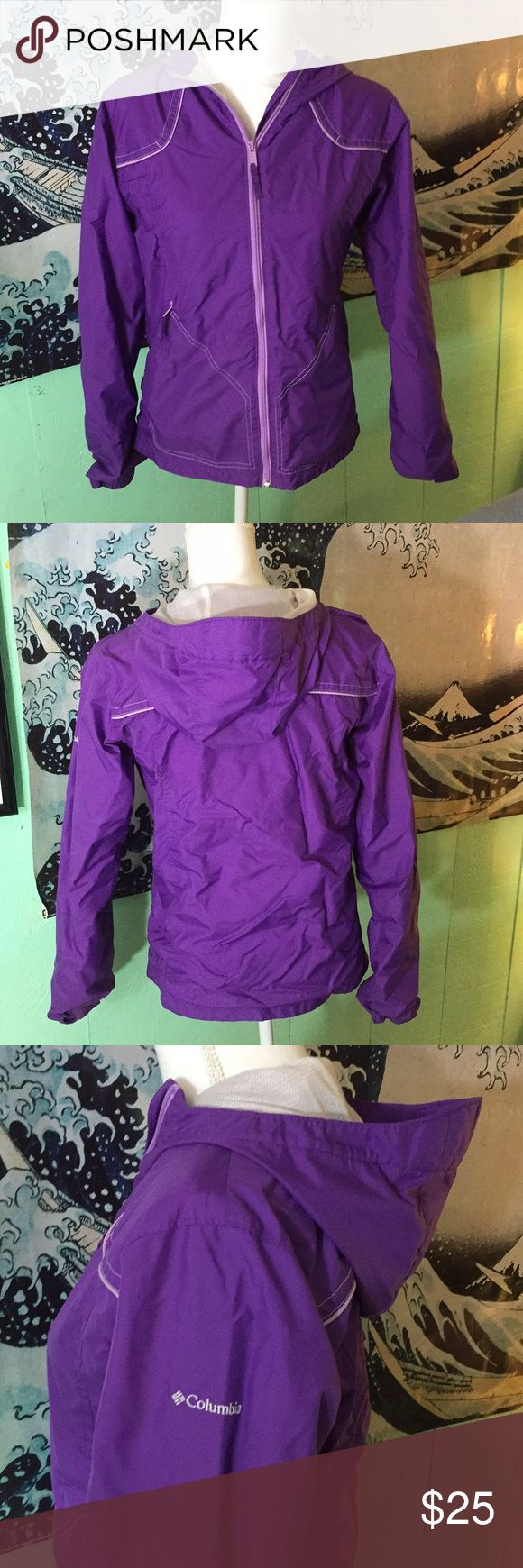 COLUMBIA PURPLE RAIN JACKET. Very clean. Excellent condition. Vibrant color purple! Size 18/20 girls . Fits a women's medium or small . Netting inside for added comfort and dryness. Hooded with two exterior pockets. Columbia Jackets & Coats