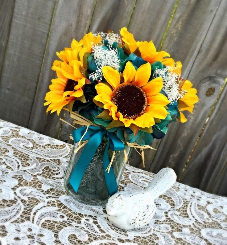 Custom Ordered Bridal Package Artificial Sunflowers, Baby's breath, Artificial Oasis Teal Hydrangeas (1) Bridal Bouquet (4) Bridesmaids Bouquets (1) Toss Bouquet (9) Boutonnières (3) Corsages (22) Centerpieces (20) Isle Runners (1) Flower girl sash (1) Flower girl hairpiece (2) Cake Clusters