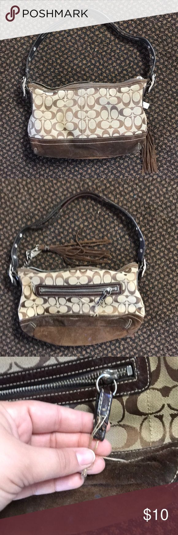 Coach hobo bag Coach hobo bag. Classic brown.  Does show wear and the one zipper has been chewed. Shown in pictures. Can snip the hanging strings but didn't want to so nothing is hidden. Very cute purse and nice size. Us buyers only. No trades. Bags Shoulder Bags