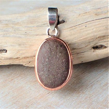 Silver and Copper Beach Stone Pendant