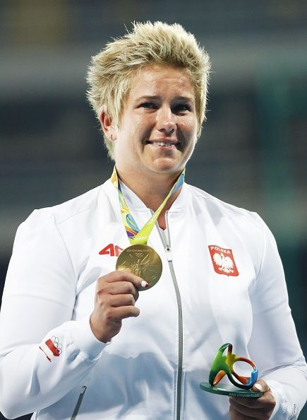 Anita Wlodarczyk of Poland holds her gold medal at the medal ceremony for the…