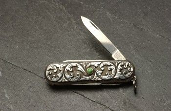Victorinox pocket knife designed by artist Lee Downey in sterling silver and Carico Lake turquoise