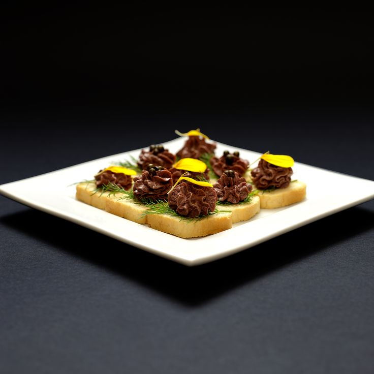Fresh made chicken liver pate on mini French Toast. These delicious canapes are now available from Lebanese Feast for you cocktail party or pre-dinner drinks.