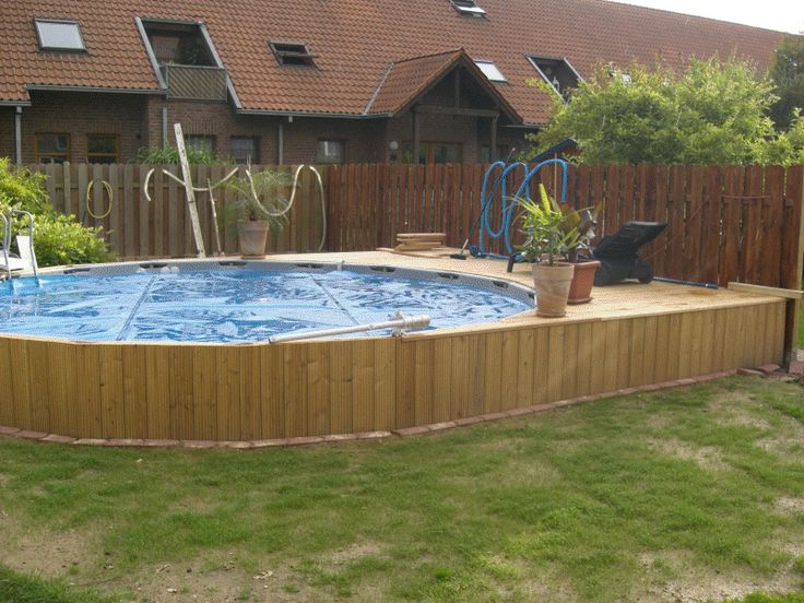 Intex frame Pool in Erde eingelassen.  Wouldn't even mind something like this.  Reasonably priced and pleasing to the eye.