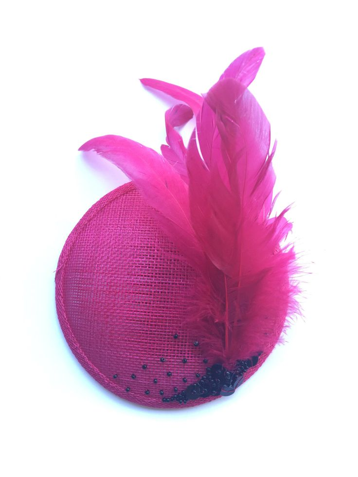 A personal favourite from my Etsy shop https://www.etsy.com/au/listing/250633833/hot-pink-fascinator-with-feather-detail
