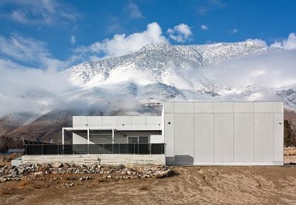Modern prefab house with white facade in Sierra Nevada mountains