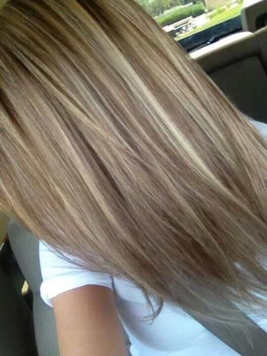 Brunette hair with blonde highlights.                              …