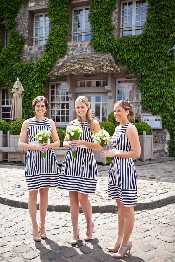 These black and white striped bridesmaids dresses are a chic and modern choice.