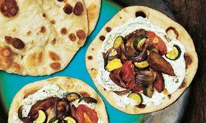 Photograph of Lavash flatbreads with mint yoghurt and vegetables