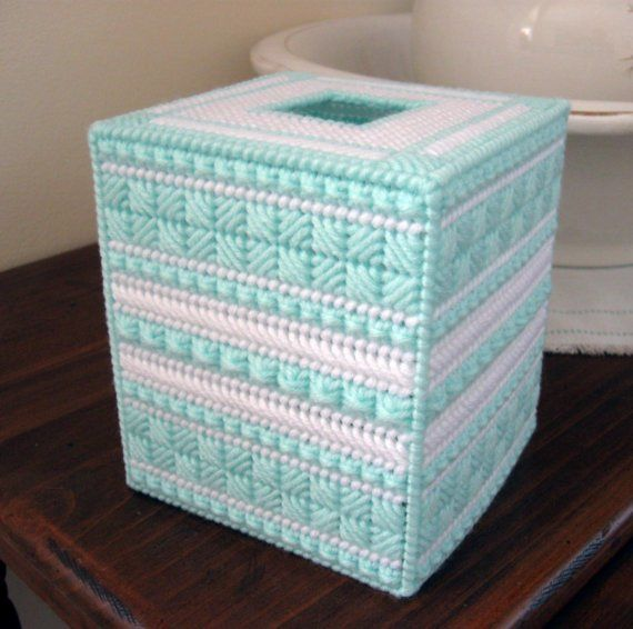 Pastel green and white design needlepointed on 7-mesh plastic canvas using acrylic yarn. It will fit a standard box of boutique-size tissues (not included). It can be washed by hand in cold water with mild soap and allowed to air dry.    Handcrafted in a smoke-free environment.