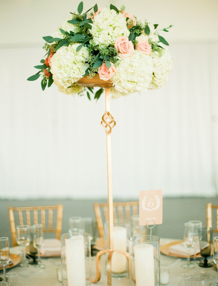 Tall Centerpiece Stand | On SMP: http://www.StyleMePretty.com/2014/02/21/crossing-vineyards-winery-wedding/ Lindsay Madden Photography