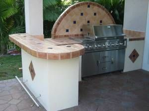 outdoor kitchen with built in bbq grill on cart to fit in grill island