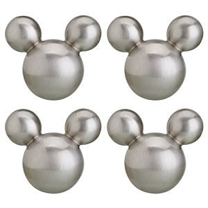 Mickey Mouse drawer pulls. ---- side note....shelves about the bench seating for pics and figurines.