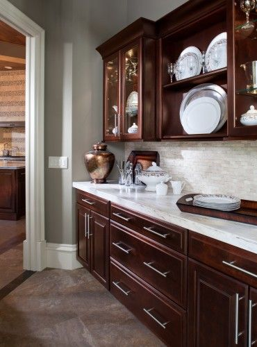 Dark brown cabinets, granite counters, and backsplash- exactly what im looking for