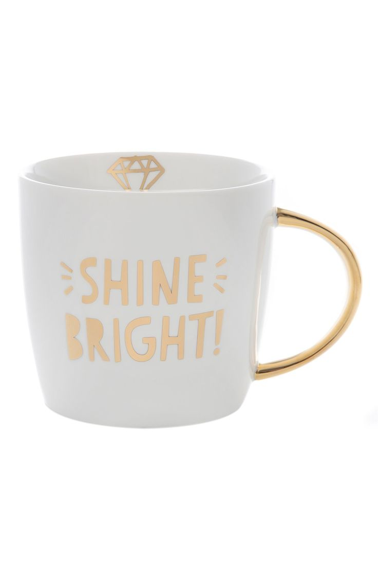 Adding a little sparkle to the morning with this ceramic mug stamped with the golden-glint announcement, 'Shine Bright,' while the interior features a simplistic diamond graphic.