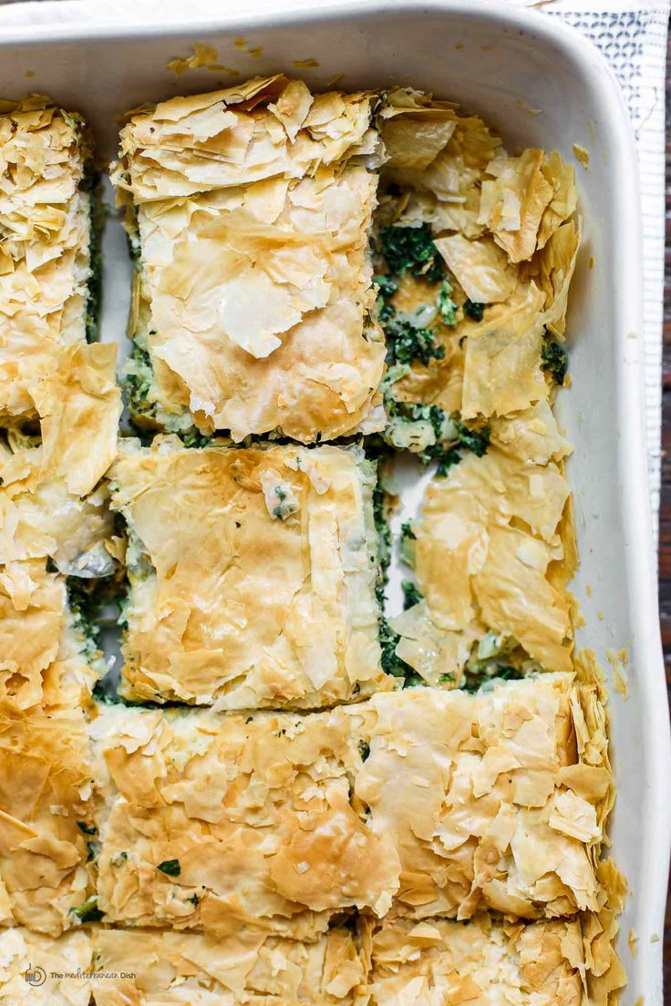 Easy, classic spanakopita recipe! Delicious Greek spinach pie with golden, crispy phyllo crust. Recipe comes with tips, video, and step-by-step photos. Foolproof!