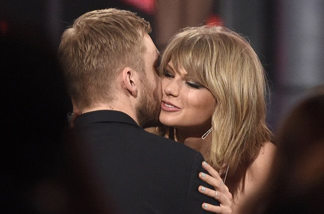 "Taylor Swift kisses Calvin Harris after winning the award for top billboard 200 album for ""1989"" at the Billboard Music Awards 2015"
