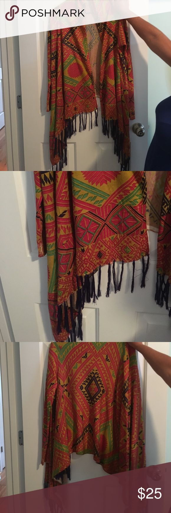 Tribal print cardigan Tribal print cardigan with tassels at the bottom! Size small NEVER BEEN WORN Sweaters Cardigans
